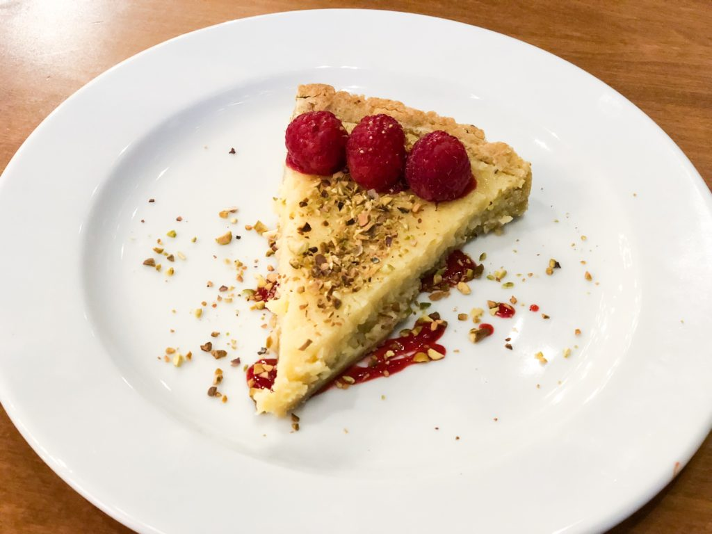 Lemon Tart with raspberry and pistachio crumbles