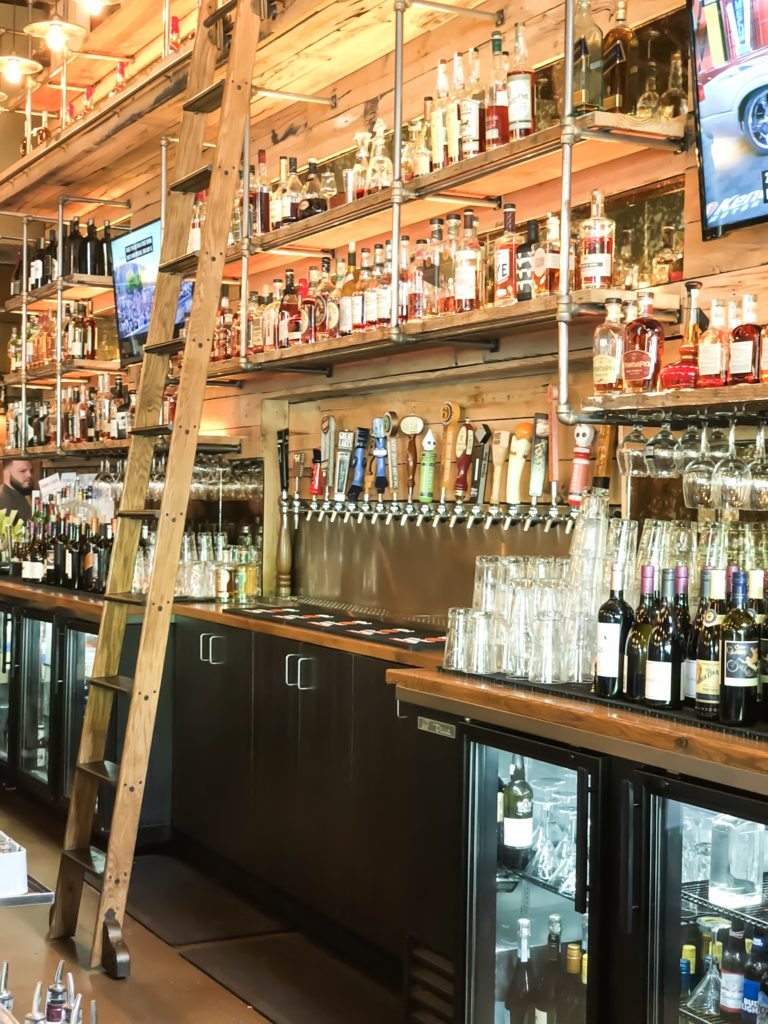 ladder in front of a full bar at a restaurant