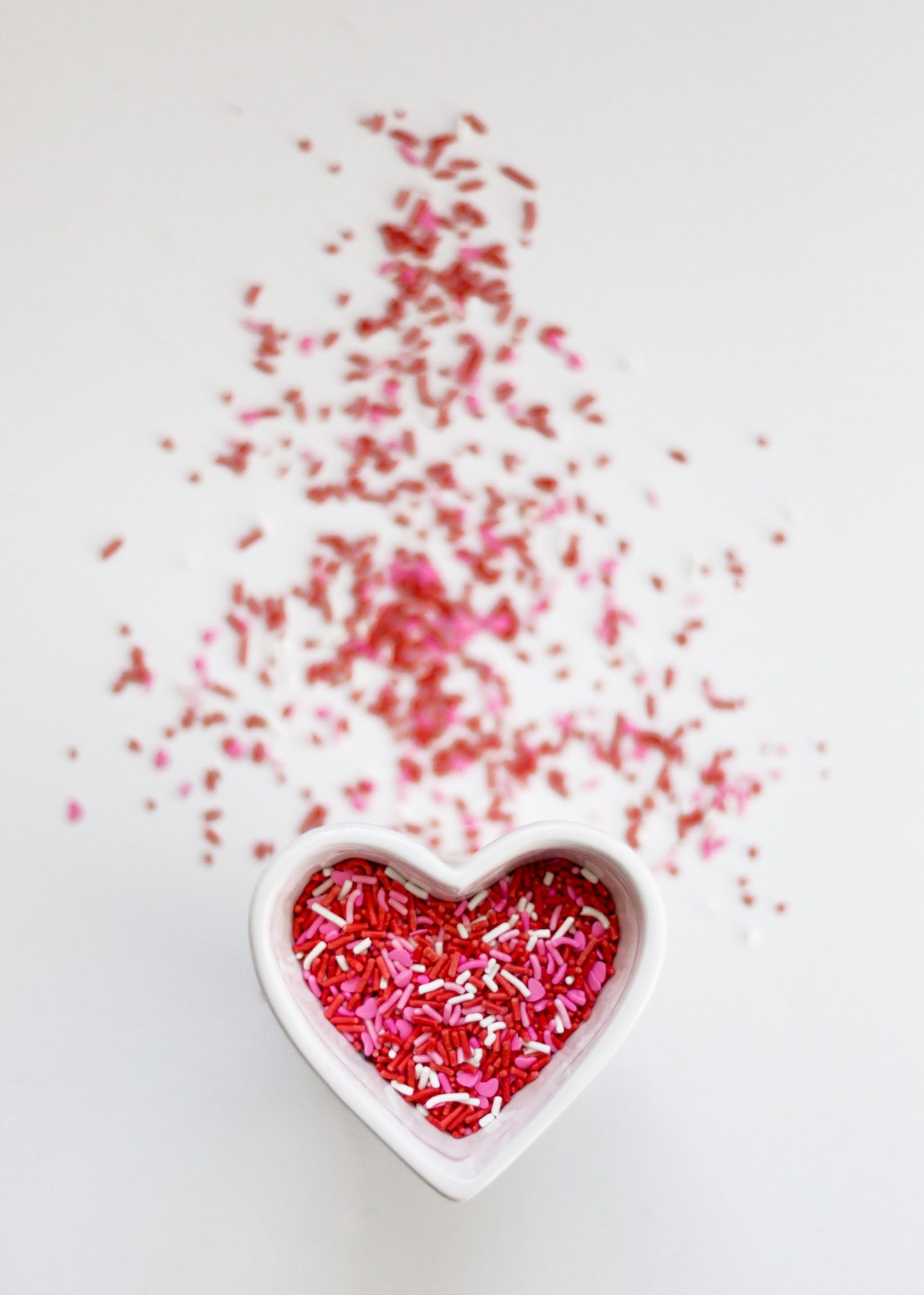 Heart shaped dish with red sprinkles for Valentine's Day