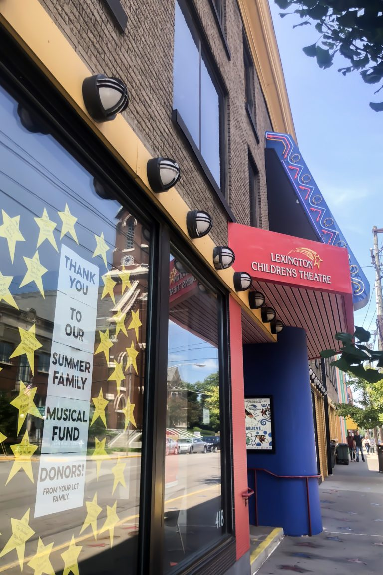 store front with stars and sign that says lexington children's theatre