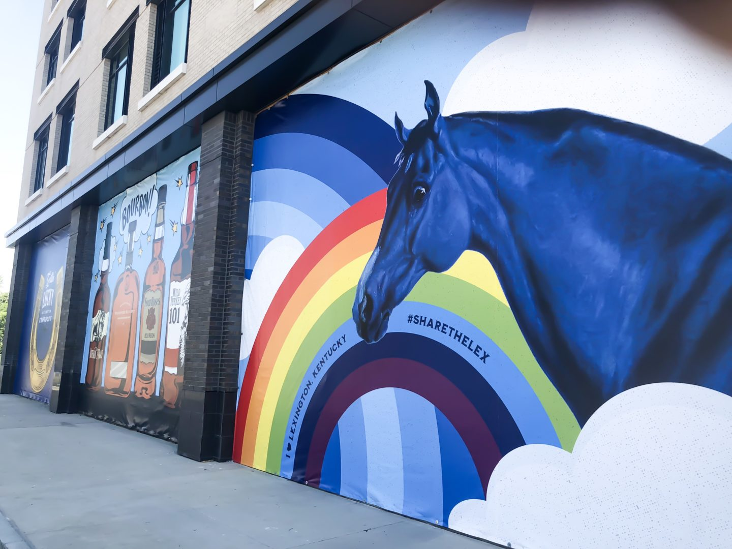 mural of blue horse and rainbow