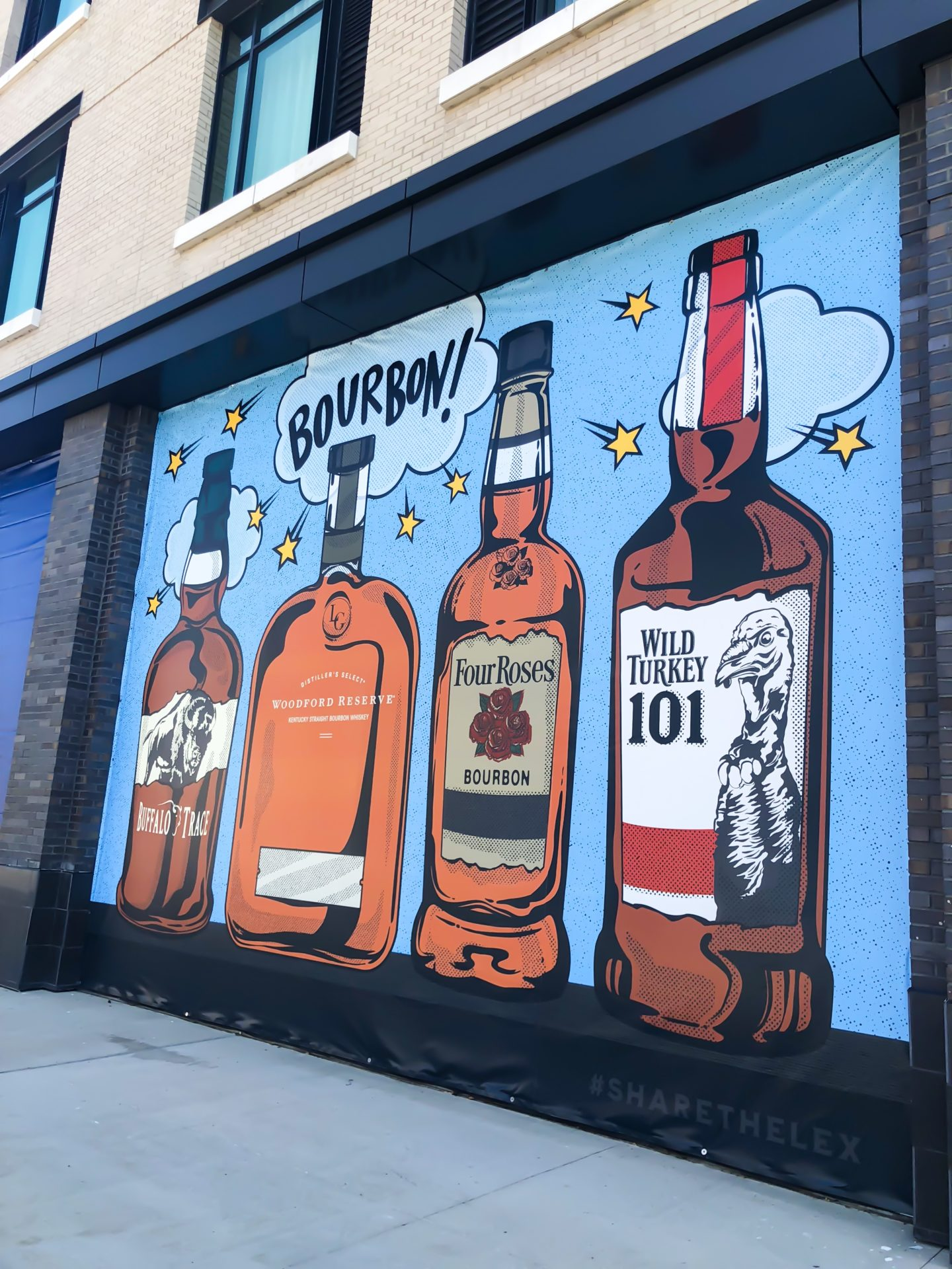 four bottles of bourbon mural