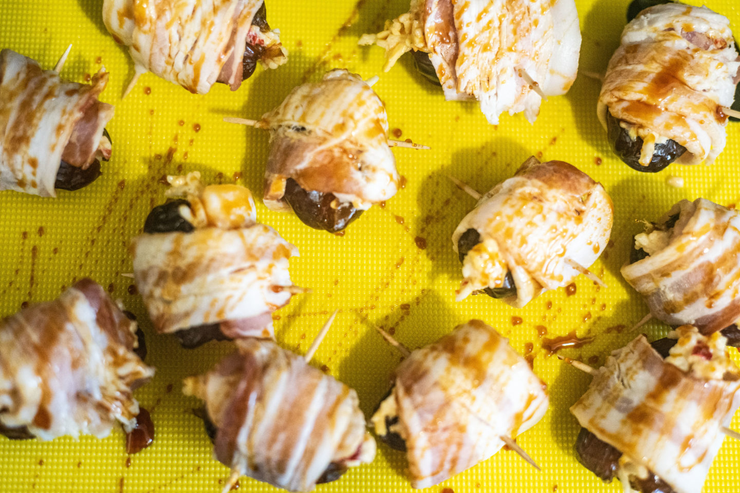 pitted dates wrapped in sorghum drizzled with sorghum