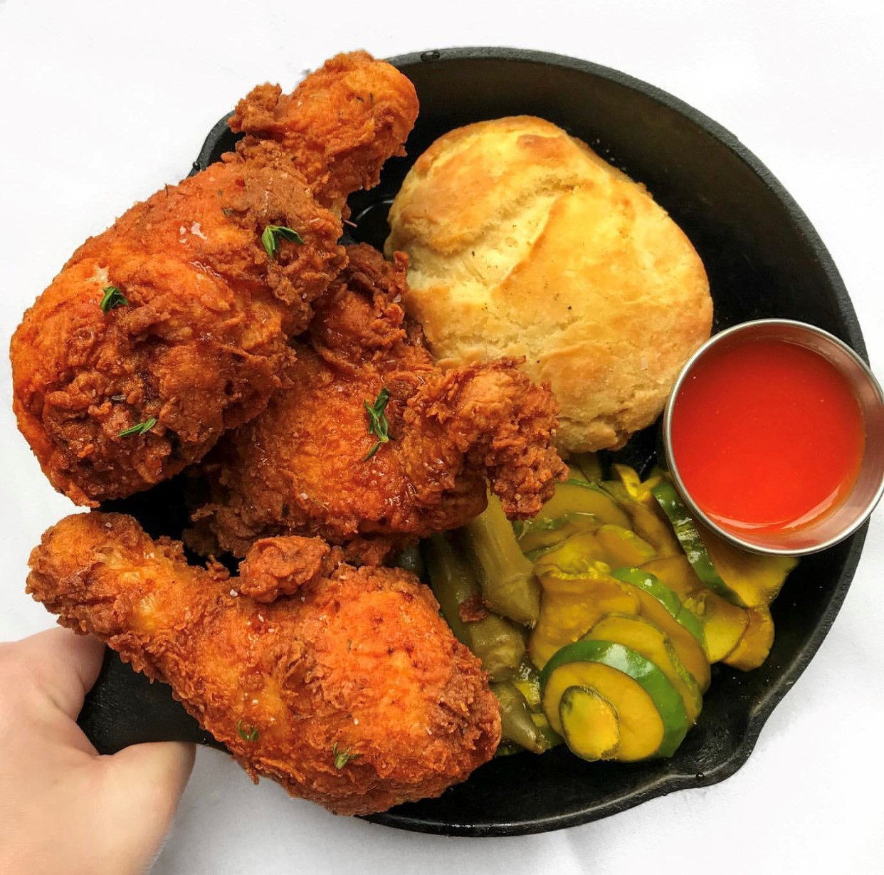 fried chicken and vegetables and a roll