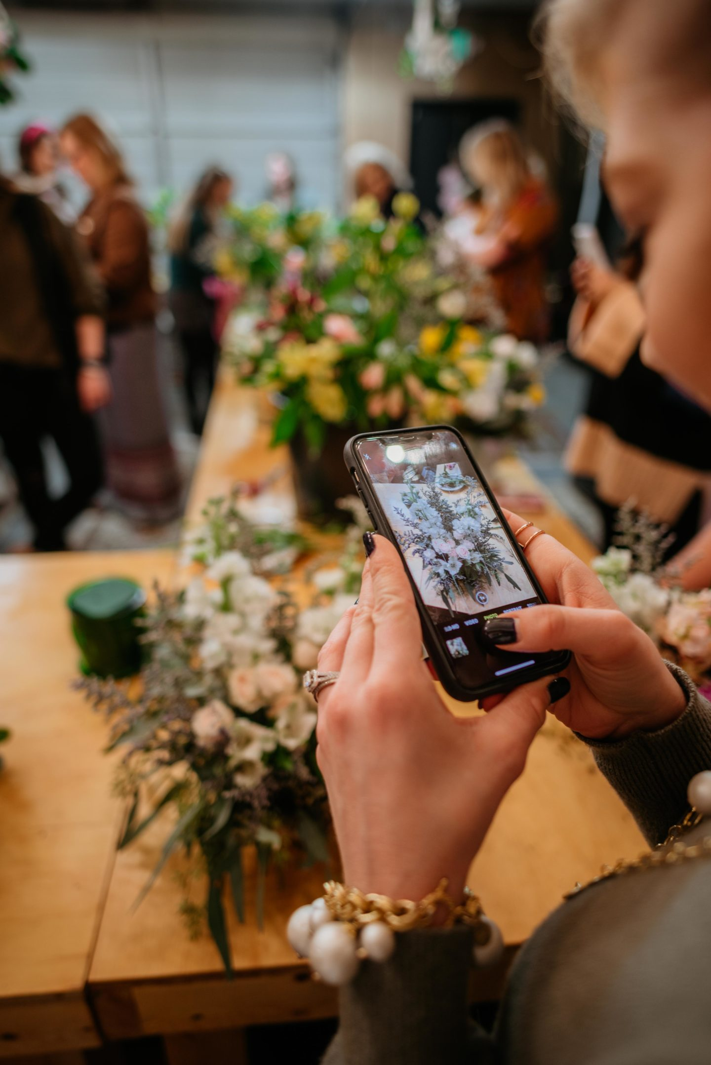 taking a photo of flowers