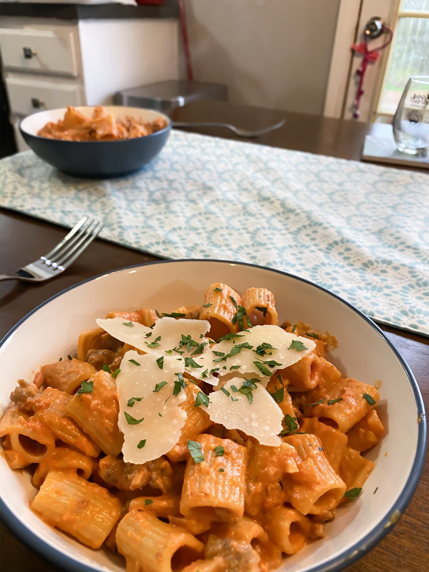 pasta in a vodka cream sauce with cheese on top