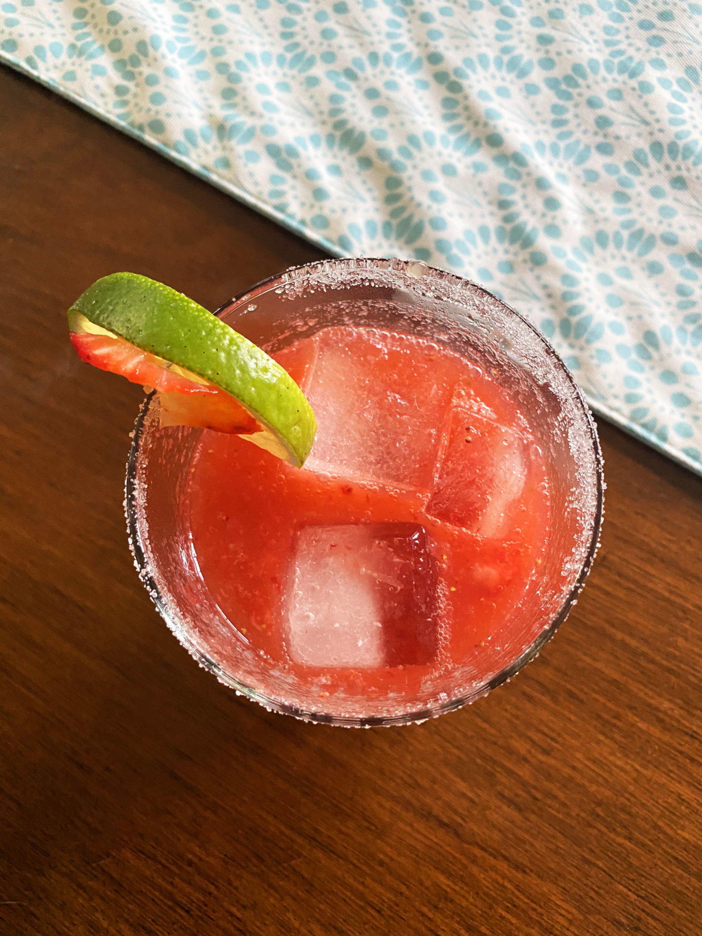 strawberry margarita with lime slice in glass